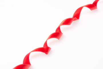 Red silk twisted ribbon in the form