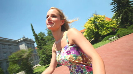 young blond woman cycling