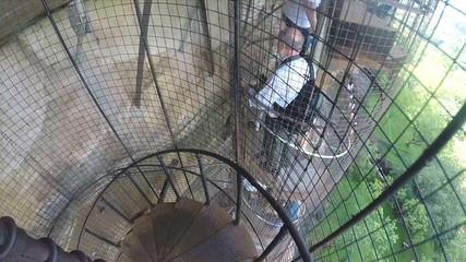 SIGIRIYA, SRI LANKA - MARCH 2014: Tourists descending spiraling metal staircase at Sigiriya.