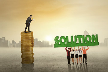 Business leader with employees and solution