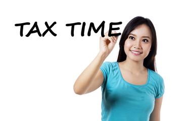 Casual girl writes tax time
