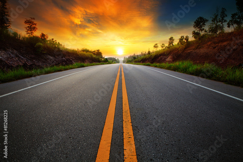 Leinwanddruck Bild beautiful sun rising sky with asphalt highways road in rural sce