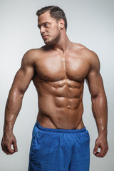 Awesome muscular male posing in studio