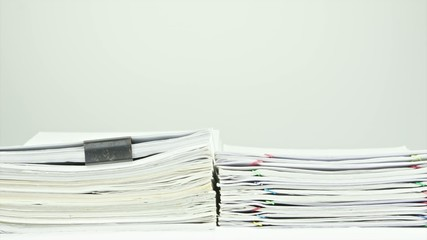 Stack old overload paperwork report on table time lapse