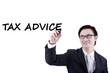 Male accountant writes tax advice on whiteboard