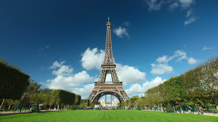 Timelapse of the eiffel tower with white clouds passing overhead in Paris, France