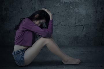 Sad and stressed girl sitting alone