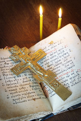 Orthodox Christian still life with old crucifixion and book