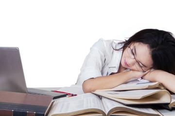 Teenage female student sleeping above books