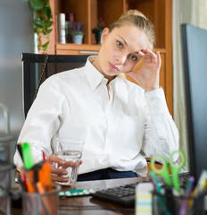 Girl with flue and pills at office