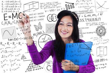 Teenage student makes math formula