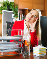 businesswoman  sitting at office desk and dreaming