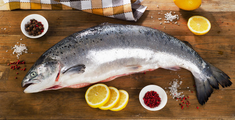Atlantic Salmon  with lemon on  wooden board.