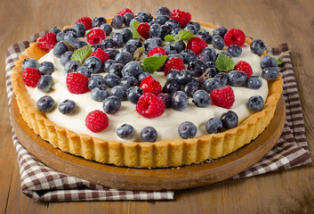 Cake with  raspberries and blueberries.