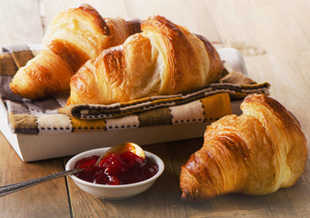 Fresh Croissants on   wooden background