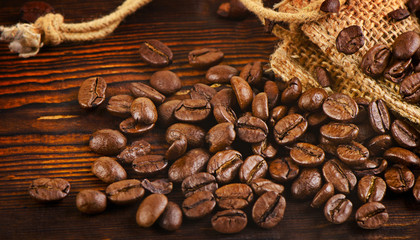 Coffee beans on a  old  wooden background