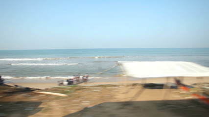 COLOMBO, SRI LANKA - FEBRUARY 2014: View of Colombo seaside from passing train. The Sri Lankan railway transports millions of people daily in the country.