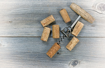 Vintage wine corkscrew with used corks