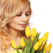 Blonde smiling woman with yellow tulips, isolated on white