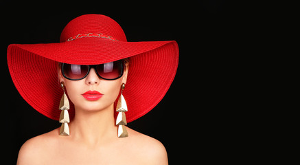 Woman in red hat and sunglasses over black