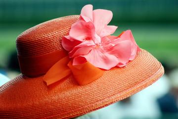 Closeup of orange hat the Kentucky Derby