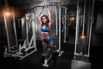 The sexy fitness woman in sport wear with perfect fitness body p