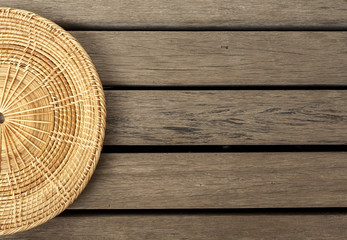 Rattan placemate on wood floor background