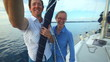 Man and woman enjoying sailboat trip on adriatic in Croatia