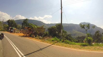 Tropical landscape from moving vehicle down the road in beautiful Sri Lanka.