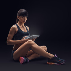 Fitness woman using a digital tablet. Img with clipping path