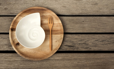 Wooden plate with space on wood floor
