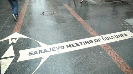 "Pan view of ""Sarajevo meeting of cultures"" written on the street of Sarajevo, Bosnia"