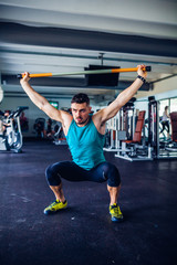 Crossfit instructor at the gym doing Exercise warmup