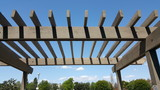 Portland wooden backyard pergola against blue sky