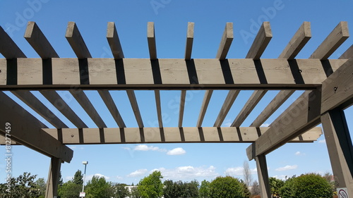 Leinwandbild Motiv Portland wooden backyard pergola against blue sky