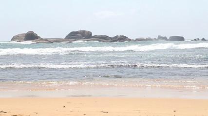 Ocean view in Hikkaduwa with waves splashing the beach. Hikkaduwa is famous for its beautiful sand beaches.