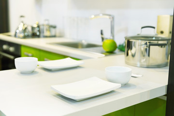 Empty white plates over plastic table