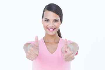 Happy woman looking at camera with thumbs up