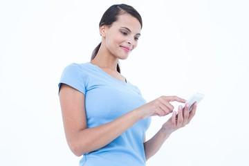 Happy brunette looking at her smartphone