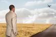 Composite image of thinking businessman
