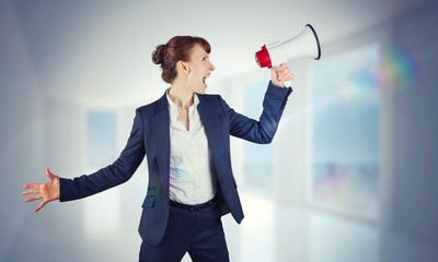 Composite image of businesswoman with loudspeaker