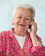 Old smiling woman talking on phone