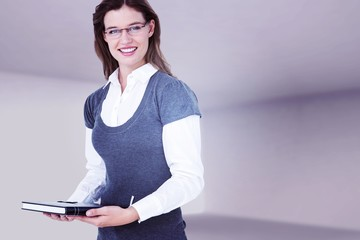 Composite image of happy woman holding diary