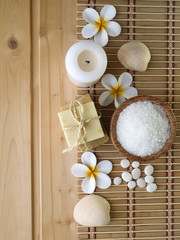 Soap and tiare flowers on the wooden background