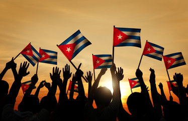 Silhouettes People Holding Flag Cuba Concept