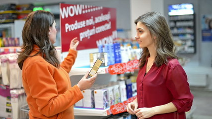 Customer choosing cosmetic products in supermarket