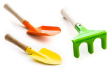 three gardening tools on a white background poster