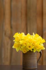 Spring daffodils in brown mug