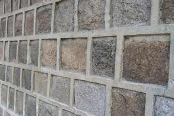 Block concrete wall closeup in view side background