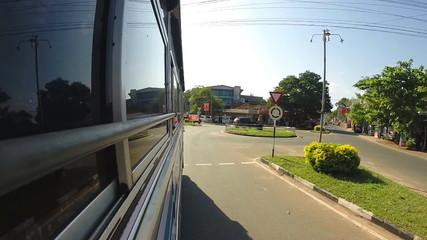 MIRISSA, SRI LANKA - MARCH 2014: View from driving bus through Sri Lankan streets.